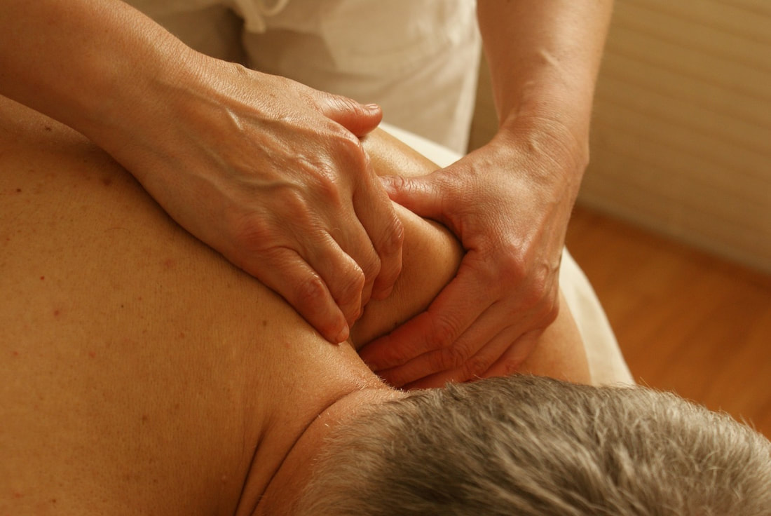 Swedish Massage on shoulder | salt lake city massage services | J Massage